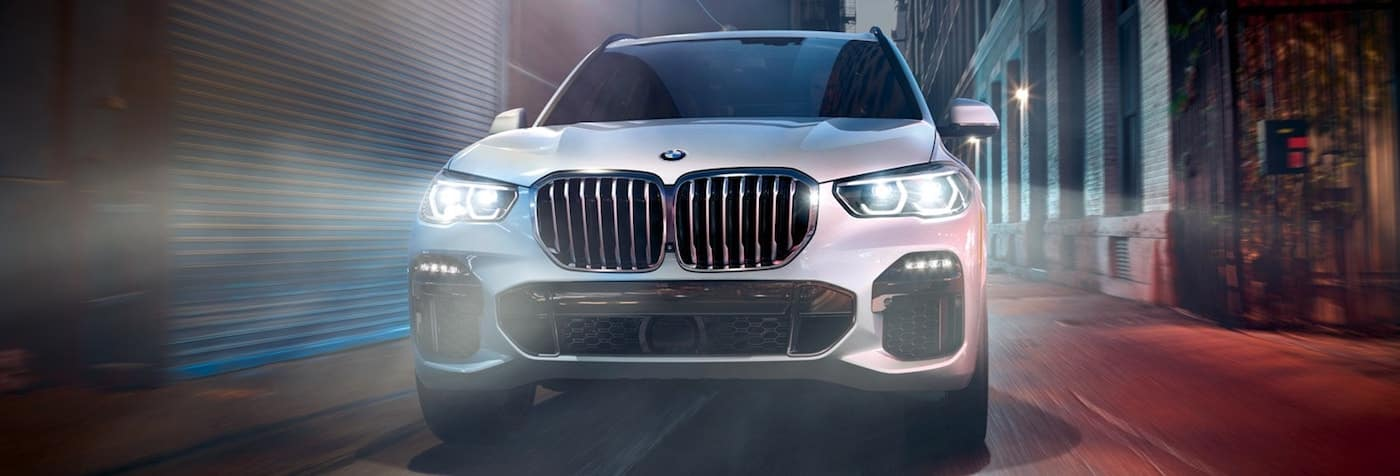 Head on view of a 2020 BMW X5 driving on a city street