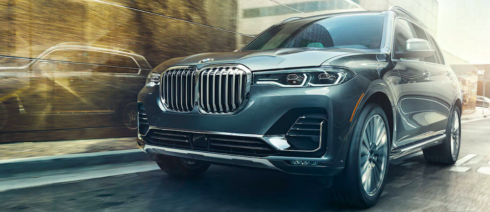 A 2020 BMW X7 driving on a city street
