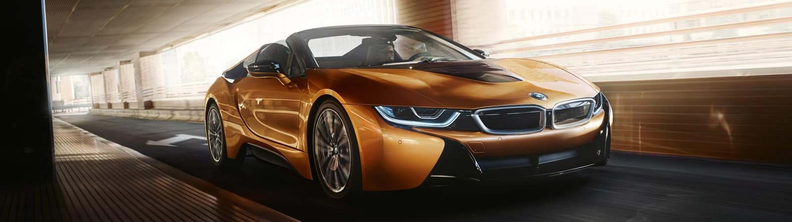 A 2020 BMW i8 Driving on a bridge