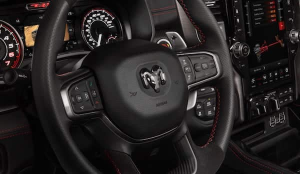 2021 RAM 1500 TRX aluminum shift paddles are integrated within the flat-bottom steering wheel