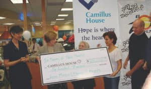 Brickell Motors presenting large check to Camillus House