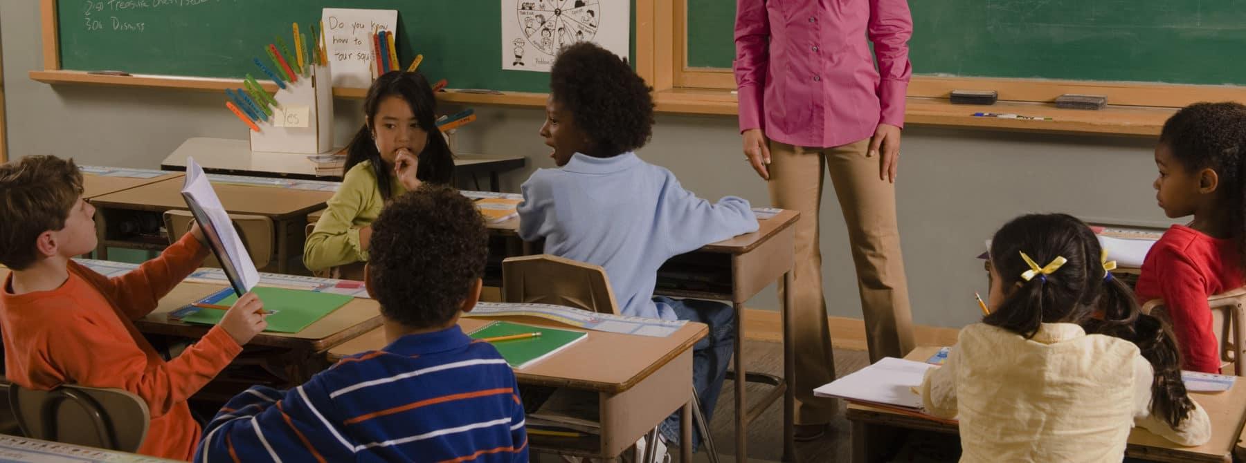 kids showing teacher answer