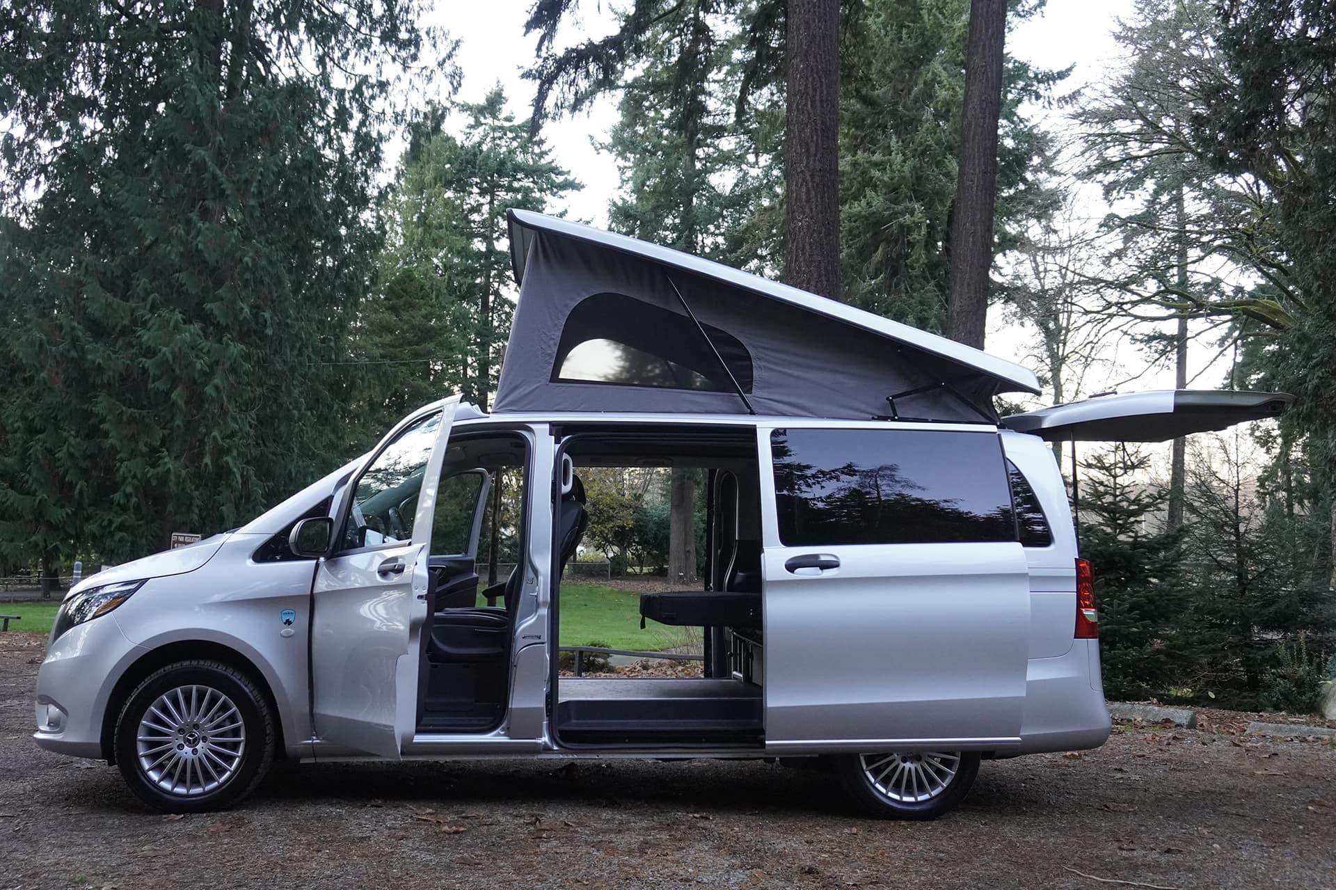 doors and pop-top open on backroad 2019 metris campervan