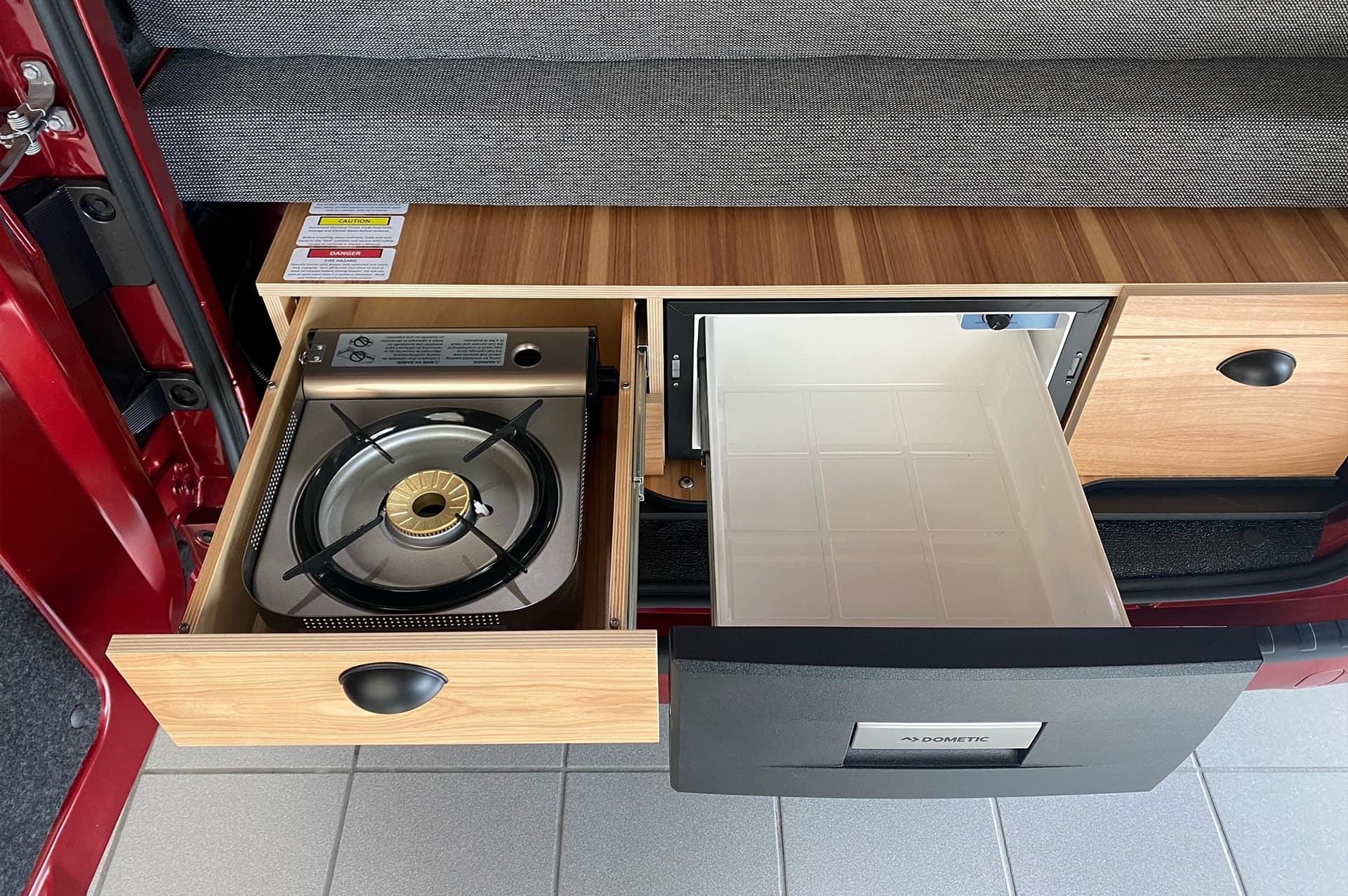 Slide out portable butane stove and 31 quart refrigerator