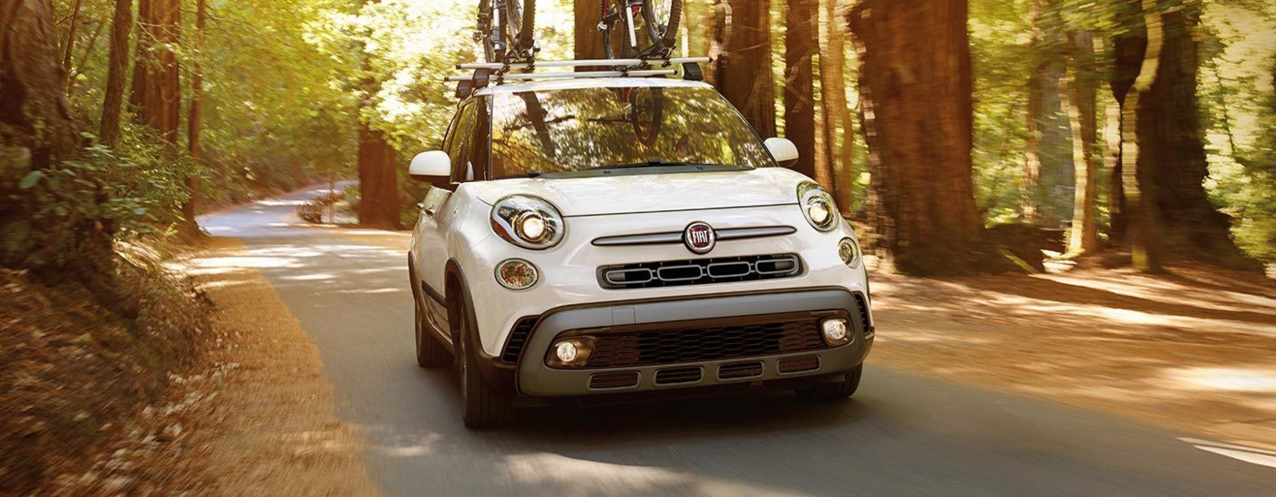 White FIAT 500L Driving Through the Forests