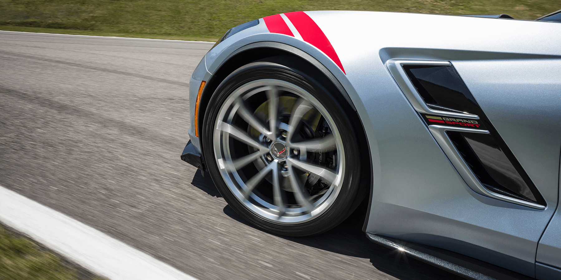 view of front left wheel and air vent of Corvette Z06