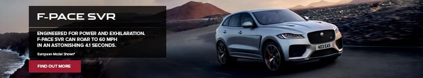 a Jaguar F-Pace SVR riding along a bend in the road on what appears to be a coastline and there is a mountain in the back ground with floating words on the left