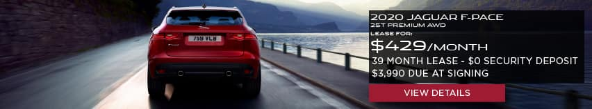 2020 JAGUAR F-PACE 25T PREMIUM.LEASE FOR $429 PER MONTH + TAX. 39 MONTH LEASE TERM. $0 SECURITY DEPOSIT. ONLY $3,990 DUE AT SIGNING. RED JAGUAR F-PACE DRIVING NEAR LAKE.