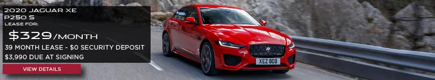 2020 JAGUAR XE P250 S. LEASE FOR $329 PER MONTH + TAX. 39 MONTH LEASE TERM. $0 SECURITY DEPOSIT. ONLY $3,990 DUE AT SIGNING. RED JAGUAR XE DRIVING THROUGH MOUNTAINS ON ROAD.