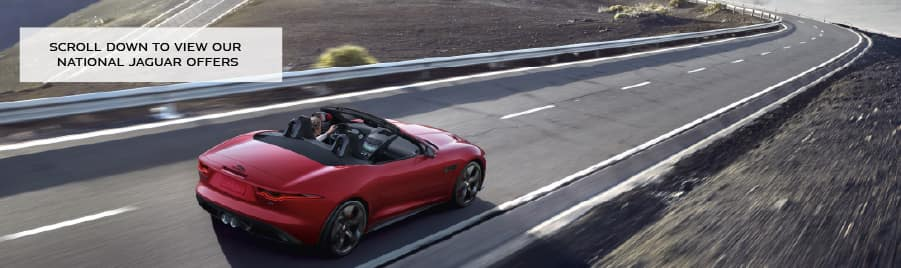 scroll down to view our national jaguar offers. Red Jaguar F-TYPE driving down road.