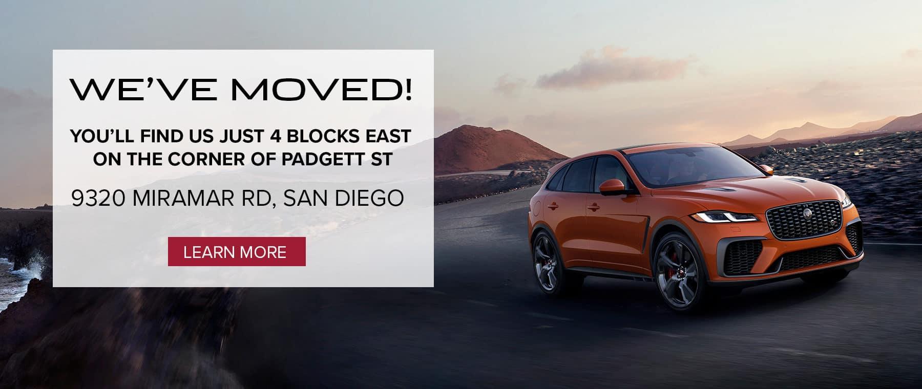 The location of the new Jaguar San Diego dealership location with an orange Jaguar