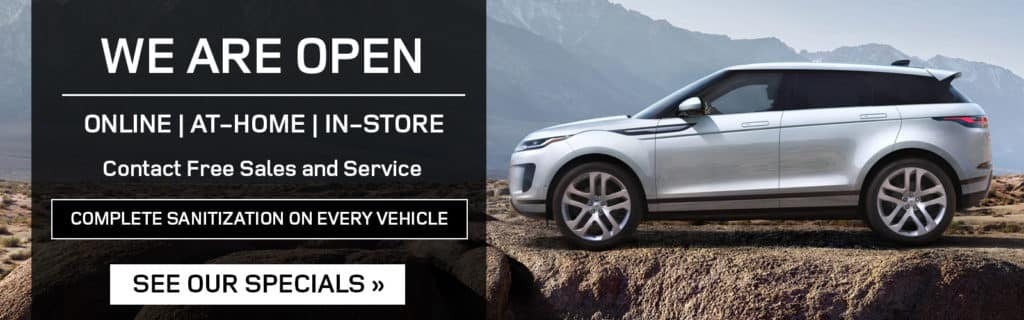 Alt Text: WE ARE OPEN. ONLINE. AT-HOME. IN-STORE. CAR SHOPPING. CONTACT-FREE DELIVERY. TEST DRIVES. VEHICLE TRADE-INS. SERVICE PICK-UP AND DROP-OFF. COMPLETE SANITATION ON EVERY VEHICLE. VIEW OUR SPECIALS. RED JAGUAR I-PACE DRIVING UP ROAD IN CITY. SILVER LAND ROVER EVOQUE PARKED ON DIRT PATH OVERLOOKING MOUNTAIN.