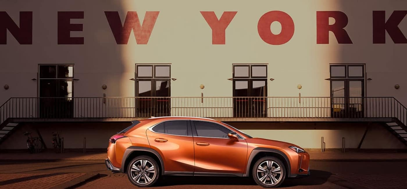 lexus ux in front of of new york sign