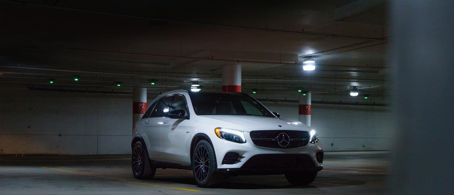 White Mercedes GLC sitting in a underground parking lot