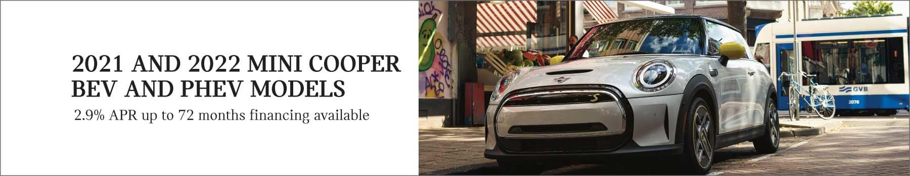 2021 and 2022 MINI Cooper BEV and PHEV Models. 2.9% APR for up to 72 months financing available. See dealer for full details. Click to view inventory. Image shows a MINI Cooper SE Hardtop 2 Door parked near the curb in an urban area.