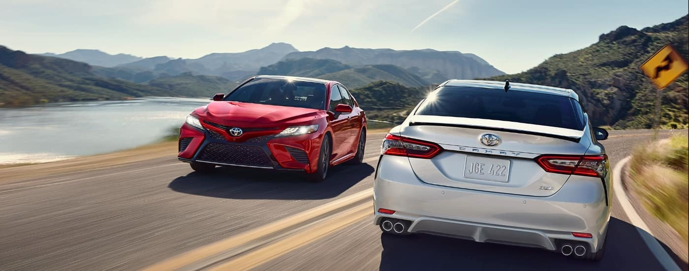 2020 Toyota Camry's driving on coast line
