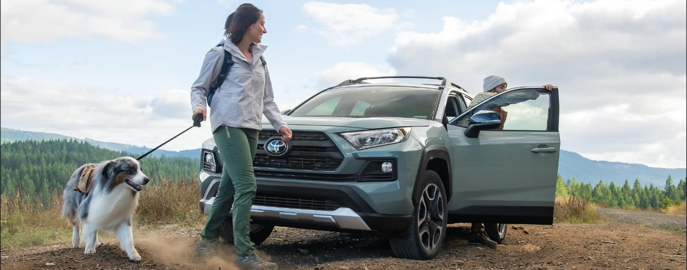 2020 Toyota RAV4 on hiking trail with family