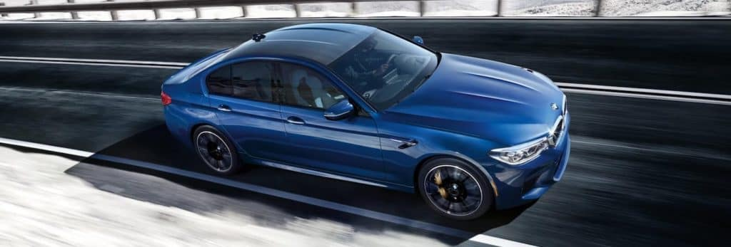 A 2020 BMW M5 taking a corner on a race track