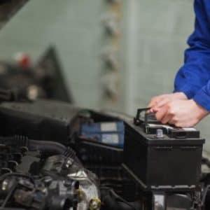 Mechanic charging car battery (1)